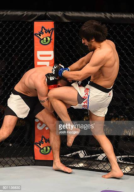 Magomed Mustafaev of Russia knees Joe Proctor in their lightweight bout during the UFC 194 event inside MGM Grand Garden Arena on December 12 2015 in...