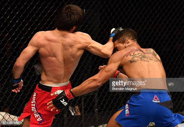 Magomed Mustafaev of Russia lands a spinning back fist against Kevin Lee in their lightweight bout during the UFC Fight Night at the SSE Arena on...