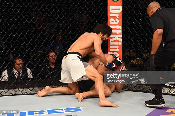 Magomed Mustafaev of Russia punches Joe Proctor in their lightweight bout during the UFC 194 event inside MGM Grand Garden Arena on December 12 2015...
