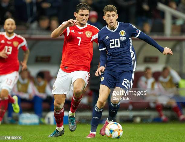 Magomed Ozdoev of Russia and Ryan Christie of Scotland vie for the ball during the UEFA Euro 2020 qualifier between Russia and Scotland on October...