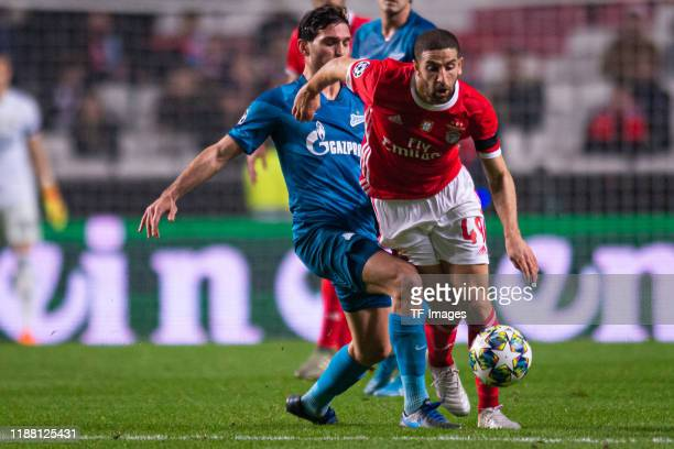 Magomed ozdoev of Zenit St Petersburg and Adel Taarabt of SL Benfica battle for the ball during the UEFA Champions League group G match between SL...