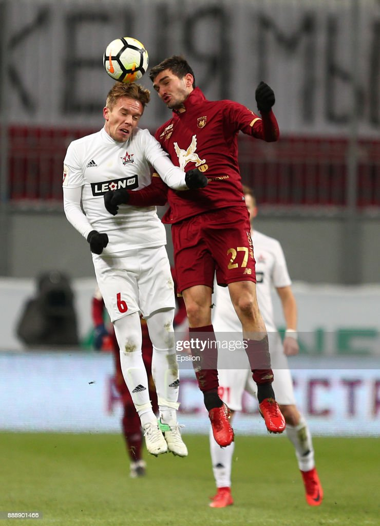 Magomed Ozdoyev (?) of FC Rubin Kazan vies for the ball with Pavel Karasyov SKA Khabarovsk during the Russian Premier League match between FC Rubin Kazan and SKA Khabarovsk at Kazan Arena stadium on December 9, 2017 in Kazan, Russia.