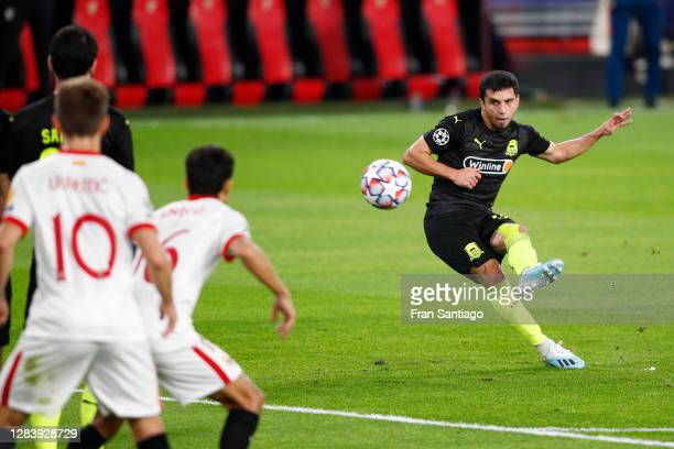 Magomed Suleymanov of FC Krasnodar scores his sides first goal from a free kick during the UEFA Champions League Group E stage match between FC...