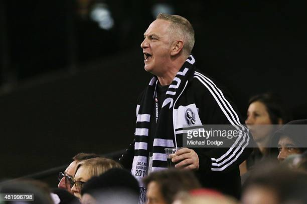 Magpie fans react after an umpiring decision during the round 17 AFL match between the Western Bulldogs and the Collingwood Magpies at Etihad Stadium...