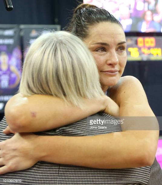 Magpies coach Kristy Keppich Birrell hugs Sharni Layton of the Magpies after the game of the round 14 Super Netball match between the Firebirds and...