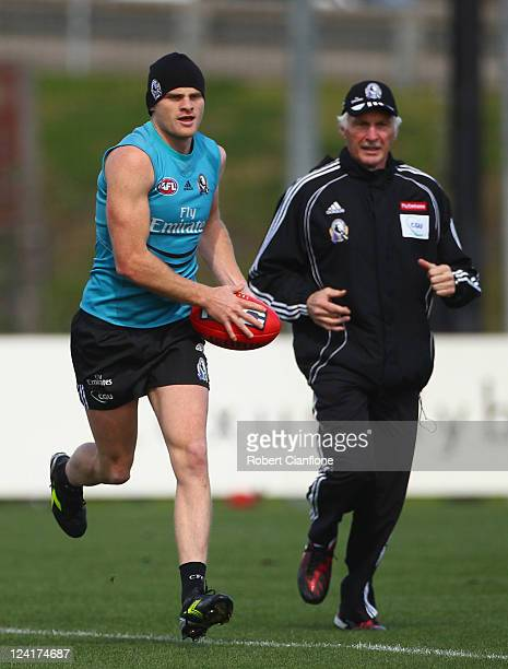 Magpies coach Michael Malthouse watches over Heath Shaw during a Collingwood Magpies AFL training session at Gosch's Paddock on September 9, 2011 in...