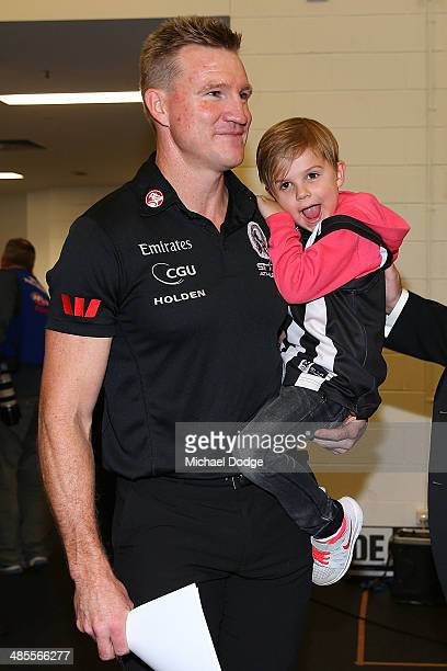 Magpies coach Nathan Buckley celebrates the win with son Ayce Buckley during the round five AFL match between the Collingwood Magpies and the North...