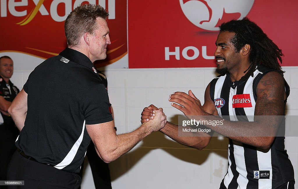 Magpies coach Nathan Buckley celebrates their win with Harry O'Brien during the round two AFL match between the Collingwood Magpies and the Carlton Blues at Melbourne Cricket Ground on April 7, 2013 in Melbourne, Australia.