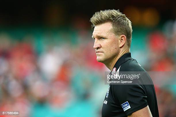 Magpies coach Nathan Buckley watches his players warm up during the round one AFL match between the Sydney Swans and the Collingwood Magpies at...
