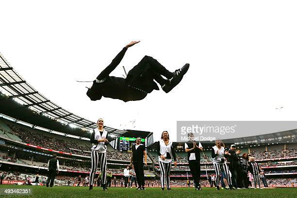 Magpies dance squad member does a backflip during the round 10 AFL match between the Collingwood Magpies and West Coast Eagles at Melbourne Cricket...