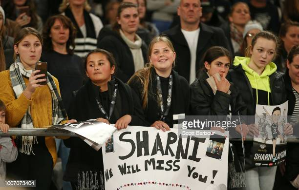 Magpies fans in the crowd show their support after Sharni Layton of the Magpies played her final home match during the round 13 Super Rugby match...