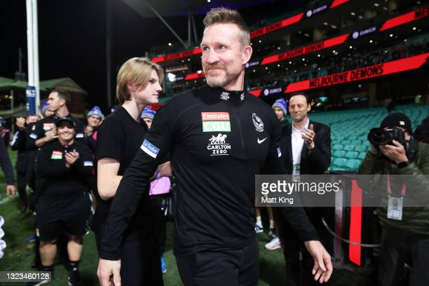 Magpies head coach Nathan Buckley celebrates victory after coaching his final game for the Magpies during the round 13 AFL match between the...