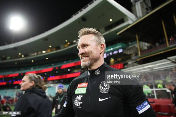 Magpies head coach Nathan Buckley celebrates victory after coaching his final match for the Magpies during the round 13 AFL match between the...
