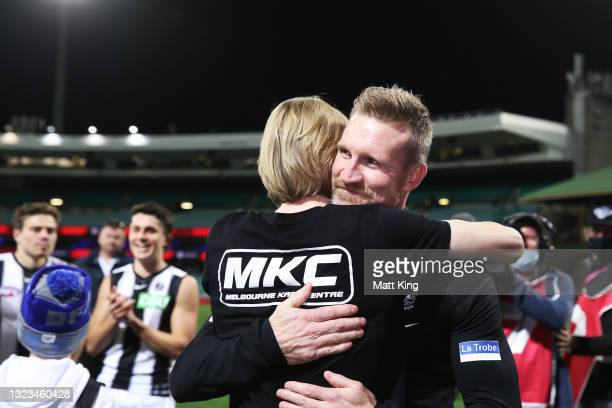 Magpies head coach Nathan Buckley celebrates victory with son Jett Buckley after coaching his final game for the Magpies during the round 13 AFL...