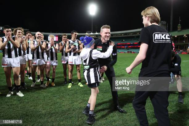 Magpies head coach Nathan Buckley celebrates victory with sons Ayce Buckley and Jett Buckley after coaching his final game for the Magpies during the...