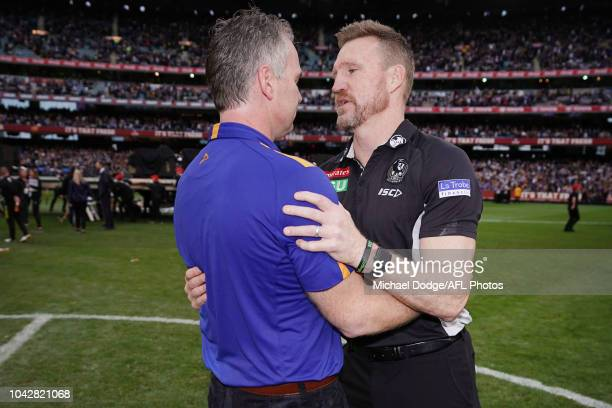 Magpies head coach Nathan Buckley congratulates Eagles head coach Adam Simpson after his win during the 2018 AFL Grand Final match between the...