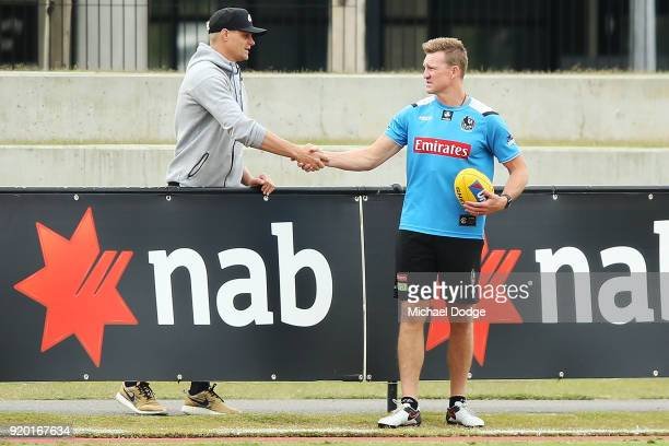 Magpies head coach Nathan Buckley is seen with former StKilda champion Nick Riewoldt during a Collingwood Magpies AFL training session at the Holden...
