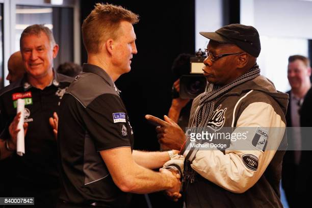 Magpies head coach Nathan Buckley listens to a Magpie fan after a Collingwood Magpies AFL press conference at the Holden Centre on August 28 2017 in...