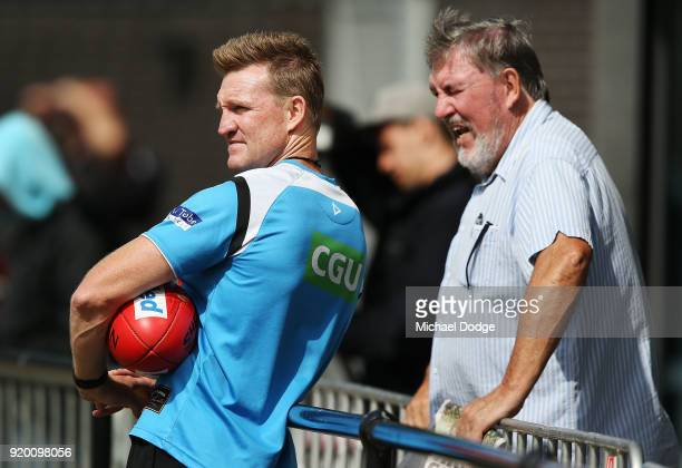 Magpies head coach Nathan Buckley looks on with his father Ray Buckley from the sideline during a Collingwood Magpies AFL training session at the...