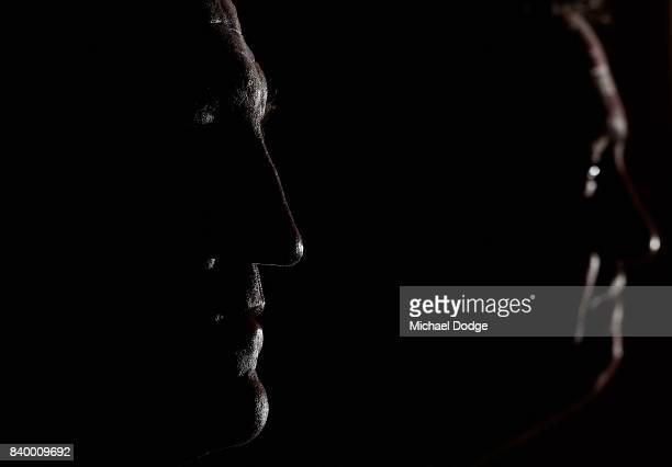 Magpies head coach Nathan Buckley looks on with President Eddie during a Collingwood Magpies AFL press conference at the Holden Centre on August 28...
