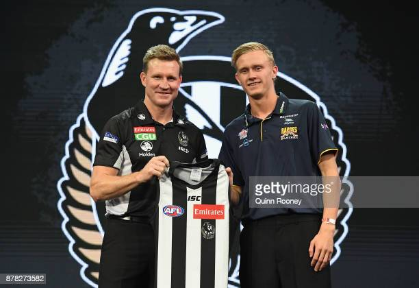 Magpies head coach Nathan Buckley poses with Jaidyn Stephenson during the 2017 AFL Draft at Sydney Showgrounds on November 24 2017 in Sydney Australia