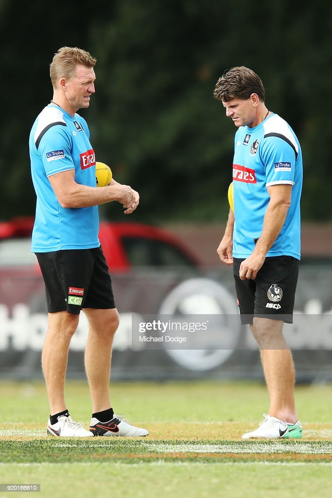 Magpies head coach Nathan Buckley speaks to his assistant Robert Harvey (R) during a Collingwood Magpies AFL training session at the Holden Centre on February 19, 2018 in Melbourne, Australia.