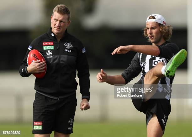 Magpies head coach Nathan Buckley speaks to Tim Broomhead during a Collingwood Magpies AFL training session at Olympic Park on May 3 2017 in...