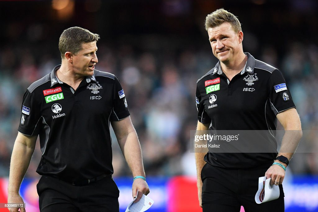 Magpies midfield coach Scott Burns and Magpies head coach Nathan Buckley walk from the field during the round 21 AFL match between Port Adelaide Power and the Collingwood Magpies at Adelaide Oval on August 13, 2017 in Adelaide, Australia.