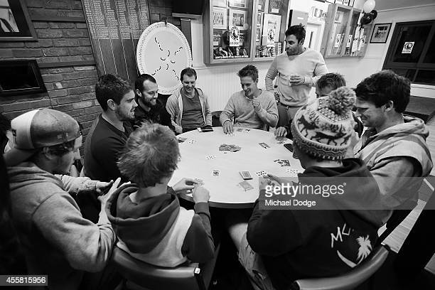 Magpies players enjoy a game of cards in the club rooms after training during the week in the lead up to the Nepean Football Netball League Grand...