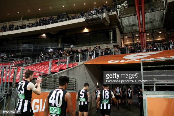 Magpies players thank fans after winning the round 6 AFL match between the Collingwood Magpies and the Hawthorn Hawks at GIANTS Stadium on July 10...