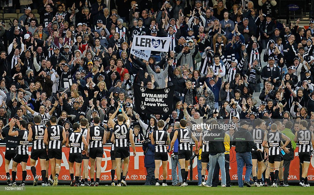Magpies players thank their supporters after their win during the round 16 AFL match between the Collingwood Magpies and the St Kilda Saints at Melbourne Cricket Ground on July 17, 2010 in Melbourne, Australia.