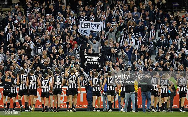 Magpies players thank their supporters after their win during the round 16 AFL match between the Collingwood Magpies and the St Kilda Saints at...