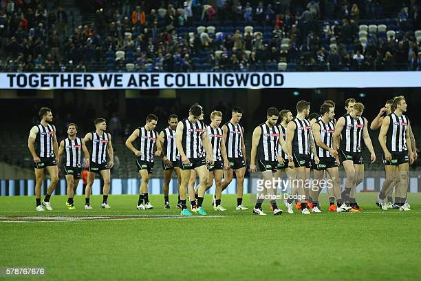 Magpies players walk of dejected after losing during the round 18 AFL match between the Collingwood Magpies and the North Melbourne Kangaroos at...