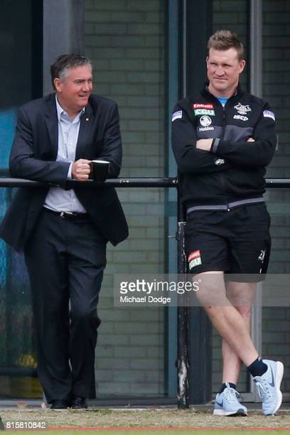 Magpies President Eddie Maguire talks with Magpies head coach Nathan Buckley during a Collingwood Magpies AFL training session at Gosch's Paddock on...