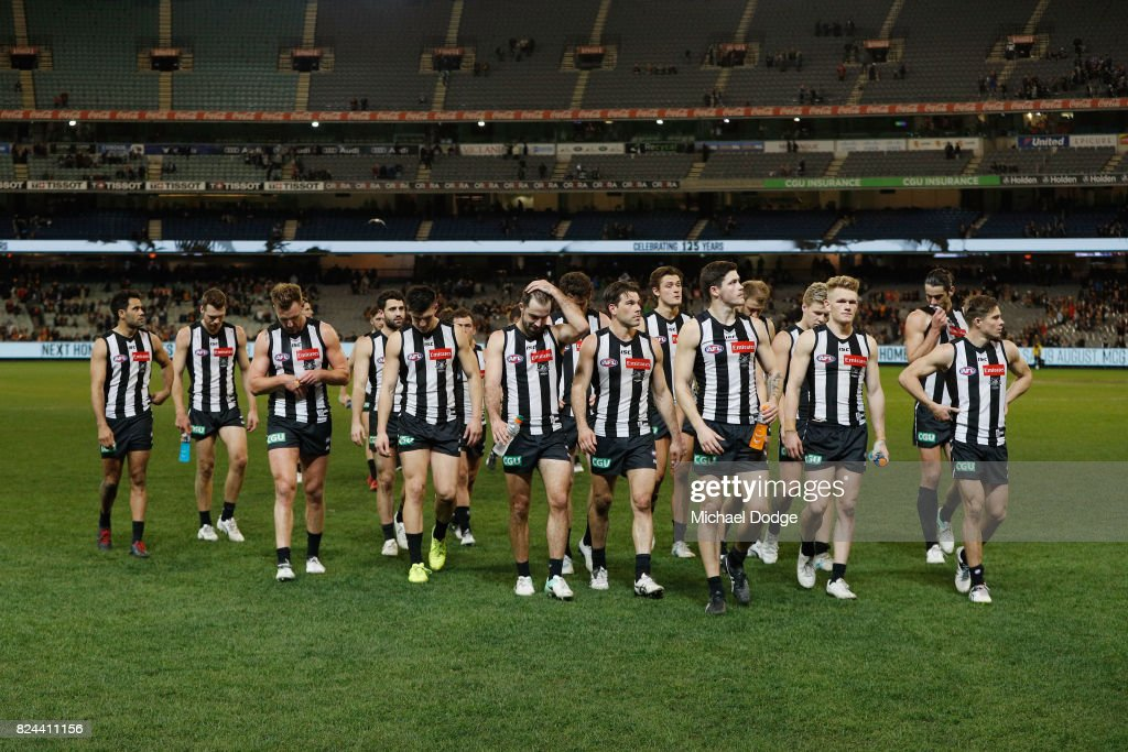 Magpies walk off after a draw during the round 19 AFL match between the Collingwood Magpies and the Adelaide Crows at Melbourne Cricket Ground on July 30, 2017 in Melbourne, Australia.