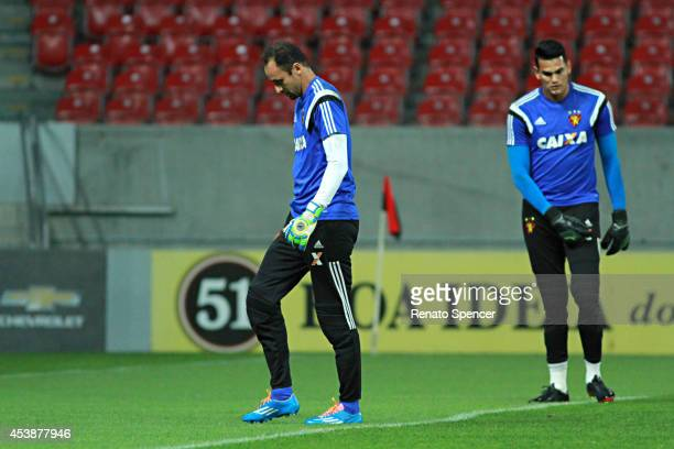 Magrao and Saulo goalkeeper of Sport Recife walk on the field during the the Brasileirao Series A 2014 match between Sport Recife and Palmeiras at...