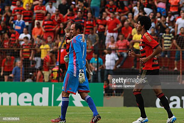Magrao goalkeeper and Pascoa of Sport Recife enter into the field before a match between Sport Recife and Atletico MG as part of Brasileirao Series A...