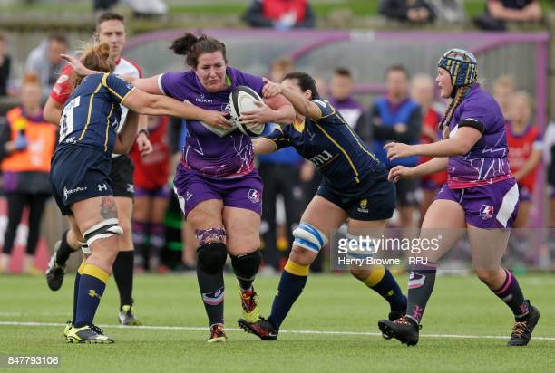 Mags Lowish of Loughborough Lightning tackled by Kirstin James of Worcester Valkyries during the Tyrrells Premier 15's match between Loughborough...