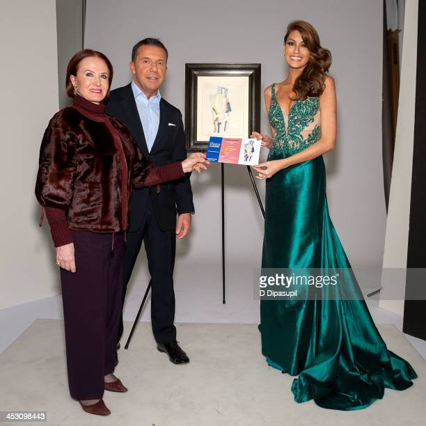 Maha Chalabi Olivier Widmaier Picasso and Miss Universe 2013 Gabriela Isler attend The Man With Opera Hat Photo Opportunity on December 2 2013 in New...