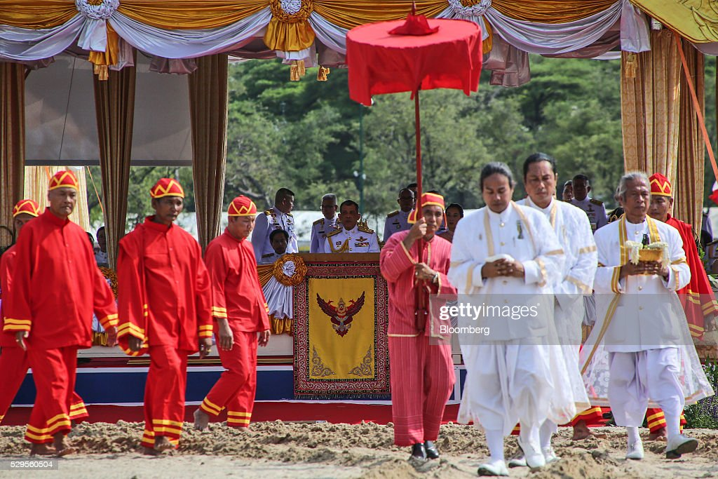 Maha Vajiralongkorn, Thailand's crown price, center, observes the Royal Ploughing Ceremony at Sanam Luang park in Bangkok, Thailand, on Monday, May 9, 2016. This year may be a better one for Thai rice production. At least, that's what two sacred oxen and a ceremonial lord forecast at an annual ploughing ceremony. Photographer: Dario Pignatelli/Bloomberg via Getty Images