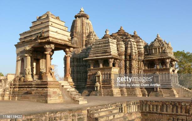 mahadeva temple (left) and devi jagdambi temple (right) at sunset in khajuraho, madhya pradesh, india - madhya pradesh stock pictures, royalty-free photos & images