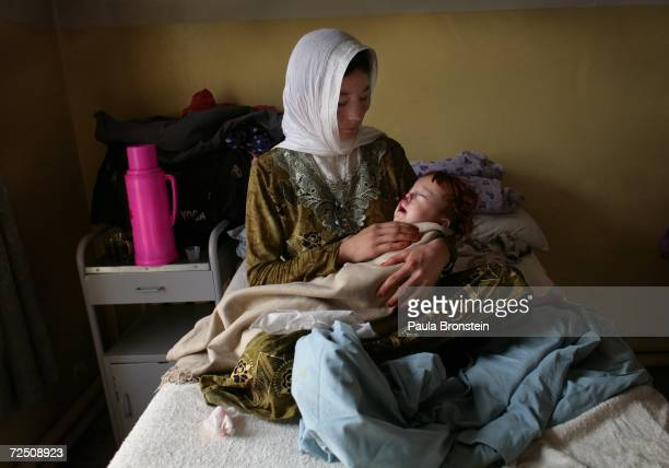Mahadi 8 months is held after her cleft palate surgery by her 16 year old mother Taza Gul at a special clinic to help cleft lip and palate patients...