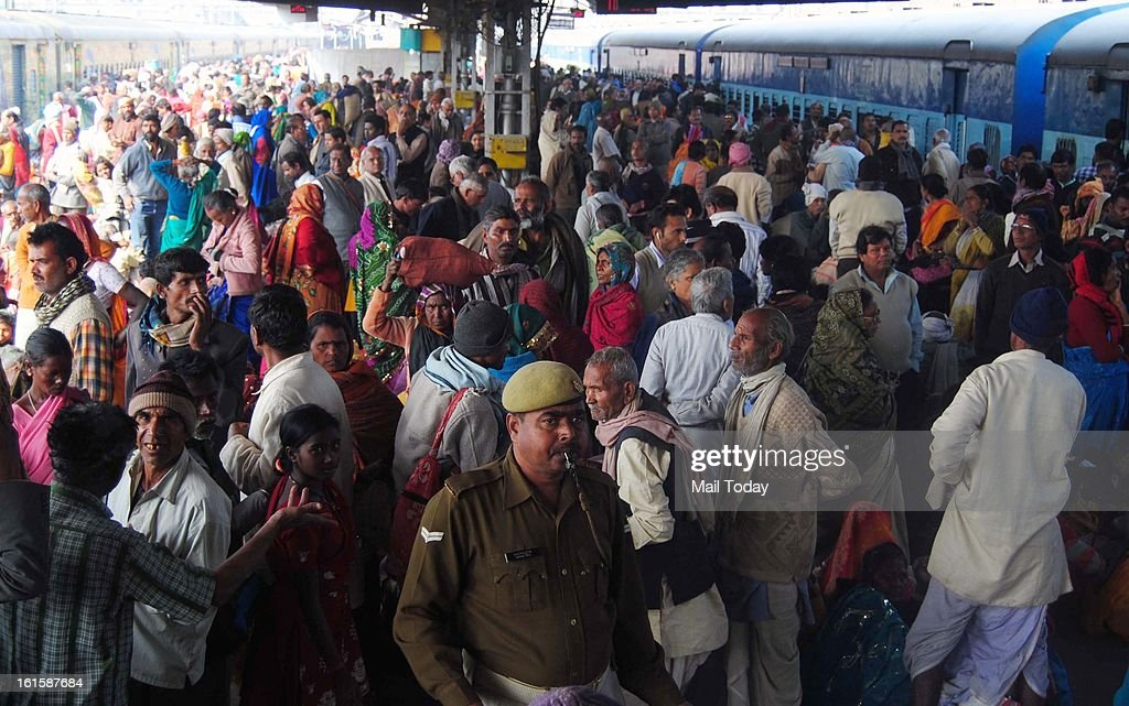 Mahakumbh devotees wait to board the trains at the Allahabad Station.
