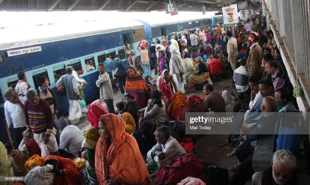 Mahakumbh devotees wait to board the trains at the Allahabad Station.