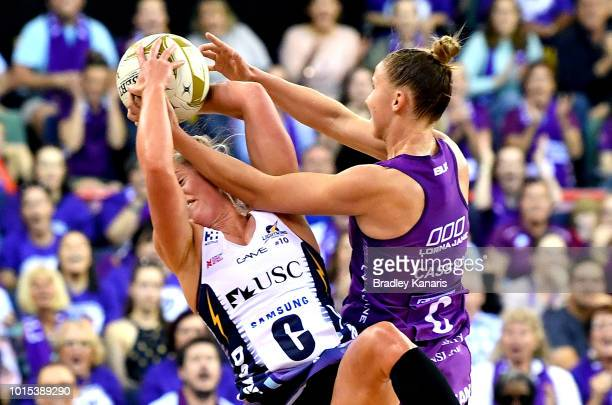 Mahalia Cassidy of the Firebirds and Laura Scherian of the Lightning challenge for the ball during the Super Netball Major Semi Final match between...