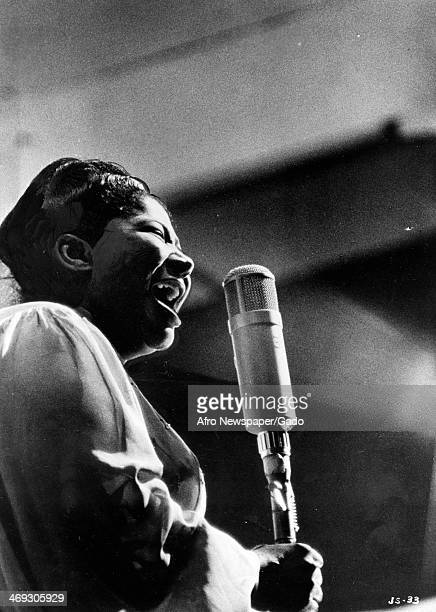 Mahalia Jackson Gospel singer sings into a microphone on stage at the Met Theatre Los Angeles California June 14 1960