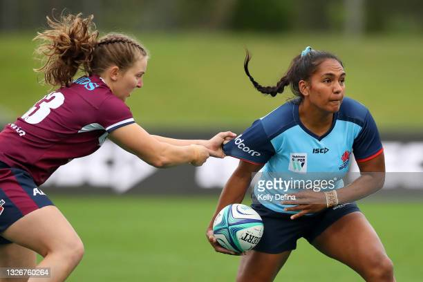 Mahalia Murphy of the Waratahs passes during the Super W Final match between the NSW Waratahs and the Queensland Reds at Coffs Harbour International...