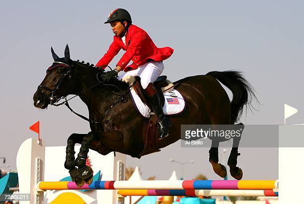Mahamad Fathil Mohd Qabil of Malaysia competes in the Equestrian Individual Jumping Qualification Round during the 15th Asian Games Doha 2006 at the...