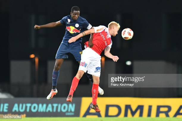 Mahamadou Dembele of Liefering and Thomas Froeschl of FC Linz go for a header during the 2 Liga match between FC Blau Weiss Linz v FC Liefering at...
