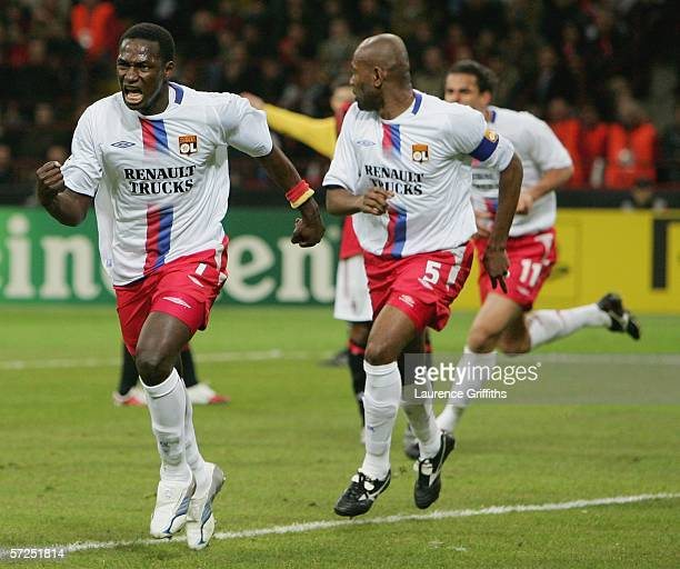 Mahamadou Diarra of Lyon celebrates scoring the equalising goal with Claudio Cacapa in pursuit during the UEFA Champions League Quarter Final Second...